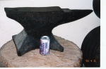 "Jowett anvil with comparison can of beer for proportion. Top anvil length 24.5""; base of anvil length 12.25""; height from base to flat top 11""; the circular part of the horn is 6.5"", with another 3"" of horn nearing the base, but this 3"" has a flat top. The circumference 6.5"" from the tip of the horn is 10.5""; the flat top of the anvil is 4.25"" wide. The anvil weighs 168lbs. Thanks again to Mike Graham for the photo."