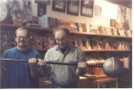 Joe Roark on the left and Kim Wood on the right in March 1993 doing some major barbell curling.  This photo was taken at Hammer Strength headquarters in Cincinnati.