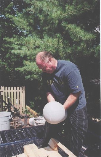 Kim Wood hoisting a Millennium bell, approx 225 lbs. July 31, 2002.