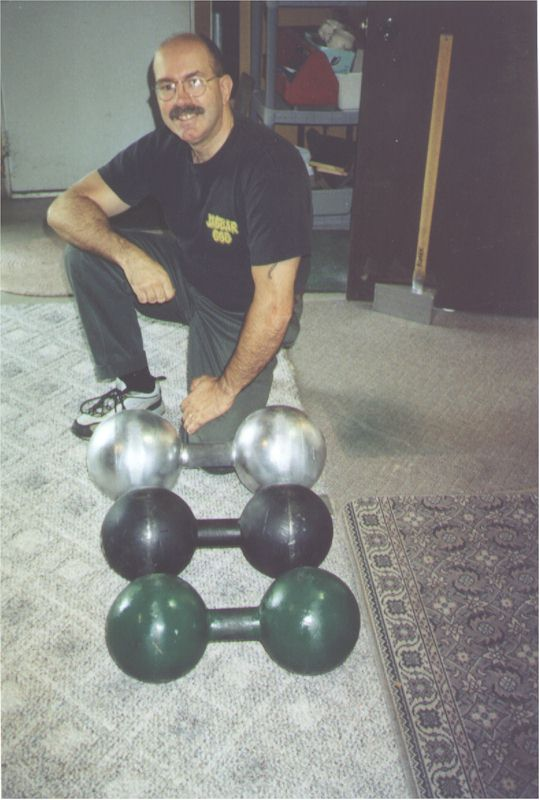 Curt Bolding with the Inch 152, the Inch 172, and the Millennium bell. Which is the 152 and which the 172? Are you sure? Check the grip board for the answer.
