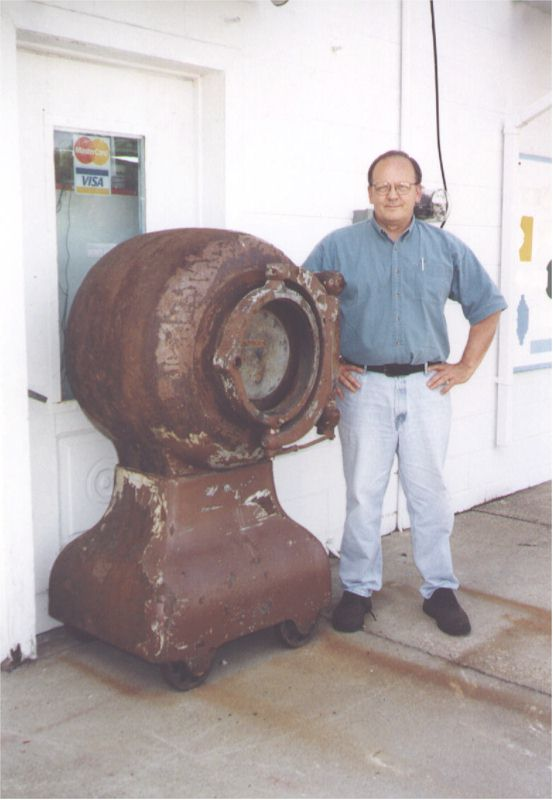 Joe Roark standing beside a cannonball type safe. This is the larger of the two types that were offered by one company. The smaller safe weighed about 2,300 pounds, and the bigger version