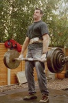 Jim Wylie doing a 2 handed deadlift, hands at front with 2 inch bar of 160kg