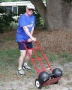 "Photo By LaVerne Bryan. Jim Bryan transporting ""Inch Challenge Dumbell"" for Bud Jeffries."