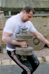 "Grip Master David Horne attempts to get an ""Inch plate loaded dumbbell"" handle weighing 78kg (172lbs) to his shoulder by continentaling it up his body.  David weights 215lbs.  Thanks to Scott Essery for all photos."