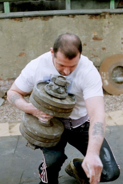 Grip Master David Horne attempts to get an &quot;Inch plate loaded dumbbell&quot; handle weighing 78kg (172lbs) to his shoulder by continentaling it up his body.  David weights 215lbs.  Thanks to Scott Essery for all photos.
