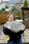 Liz Talbot lifting an 80kg rock.