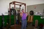 Chris James performing a 243lb barbell curl on a 2-inch thick bar.