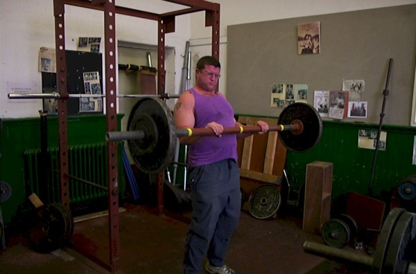 Chris performing a 154lb reverse curl with a 2-inch bar.