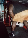 "Mark Henry lifting the Millennium Dumbbell.  Thanks to Steve ""Mobster"" Gardener for the picture."