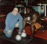 "Steve ""Mobster"" Gardener with Mark Henry and the Millennium Dumbbell."